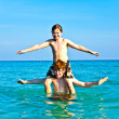 Stock Photo: Brothers are playing together in beautiful sewith crystal clear water a