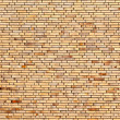 Beige yellow brick wall — Stock Photo