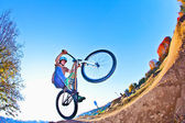 Boy going airborne with his bike — Stock Photo