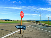 Traffic sign stop and one way at the street — Stock Photo