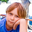 Boy with brown hair is looking displeased — Stock Photo