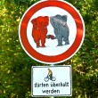 Sign forbidden for elefants in love and bicycle overtaking allow - Stock Photo