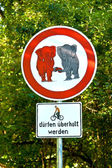 Sign forbidden for elefants in love and bicycle overtaking allow — Stock Photo