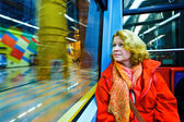 Beautiful woman looking out of the subway window — Stock Photo