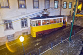 Lisbon at night, famous tram, historic streetcar is running — Stock Photo