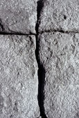 Volcanic stone with cracks forming a cross — Stock Photo