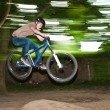 Child has fun jumping with the bike over a ramp — Stock Photo