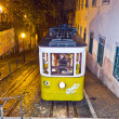 Lisbon at night, famous tram, historic streetcar is running - Stockfoto