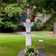 Stock Photo: Old painted crucifix to remember dead priest near Trittenheim,