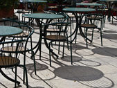 Cafe tables and chaires french style with shadow — Stock Photo