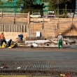 Workers at the construction site preparing the base plate — Stock Photo #6083406