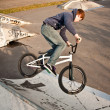 Stock Photo: Boy riding his bike at skatepark