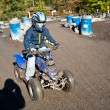 Child loves to race with a quad bike at the muddy quad track — Stock Photo #6084860