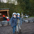 Child loves to race with a quad bike at the muddy quad track — Stock Photo #6085036