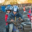 Child loves to race with a quad bike at the muddy quad track — Stock Photo #6085133