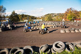 Child loves to race with a quad bike at the muddy quad track — Stock Photo