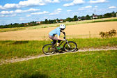 Boy racing with his bike in open area — Stock Photo