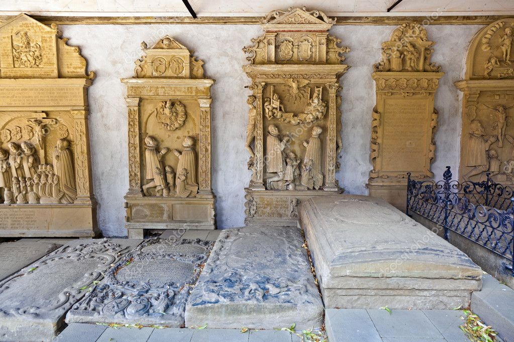 Historic gravestones in cemetery of medieval city marktbreit — Stock Photo #6113915