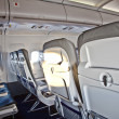 Inside the cabin of an aircraft - Stock Photo