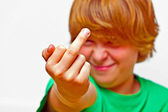 Boy showing his finger — Stockfoto