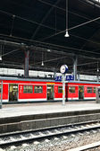 Train in classicistic train station — Stock Photo