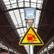 Warning sign and speaker in classicistical railway station — Stock Photo #6181836
