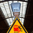 Warning sign and speaker in classicistical railway station — Stockfoto