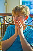 Blond boy looks astonished — Stock Photo