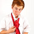 Teenager binding his red tie — Stock Photo