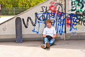 Boy resting with skate board at the skate park — Stock Photo