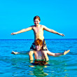 Stock Photo: Brothers are enjoying clear warm water at beautiful beach and playi