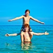 Stock Photo: Brothers are enjoying clear warm water at beautiful beach