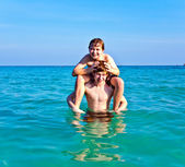 Brothers are enjoying the clear warm water at the beautiful beach — Stock Photo
