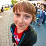 Cute young boy smiles — Stock Photo