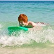 Boy has fun surfing in the waves — Stock Photo