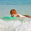 Boy has fun surfing in the waves — 图库照片