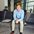 Boy waiting in the gate at the airport for the call of boarding — Stock Photo #6375701