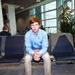 Boy waiting in the gate at the airport for the call of boarding — Stock Photo #6375722
