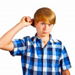 Young boy brushing his hair — Stock Photo