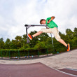 Boy jumping with his scooter — Stock Photo #6460900