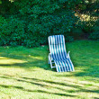 Deck chair on the grass without — Stock Photo