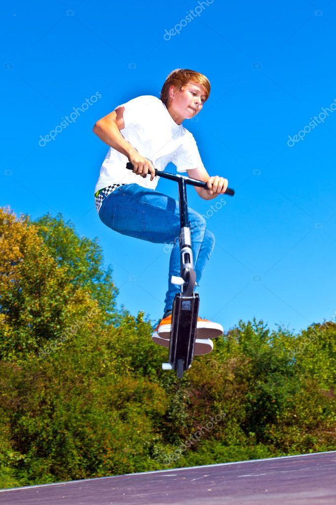 Boy jumping with his scooter — Stock Photo #6460963