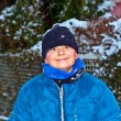 Boy has fun in winter landscape in snow — Stock Photo #6518536
