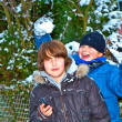Boy has fun in winter landscape in snow — Stock Photo #6518551