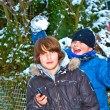 Boy has fun in winter landscape in snow — Stock Photo
