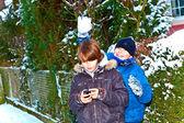 Boy has fun in winter landscape in snow — Stock Photo