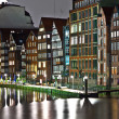 Old townhouses at the canal in Hamburg by night — Stock Photo #6549991
