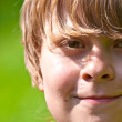 Portrait of cute smiling boy in nature — Stock Photo