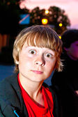 Portrait of boy by night in the town — Stock Photo
