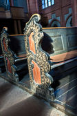 Old wooden historic benches in the cathedral of Wetzlar — Stock Photo